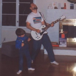 My dad teaching me guitar (he doesn't really play either).